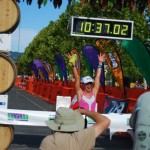 Defending her title in 2009, with a time of 10:21:54