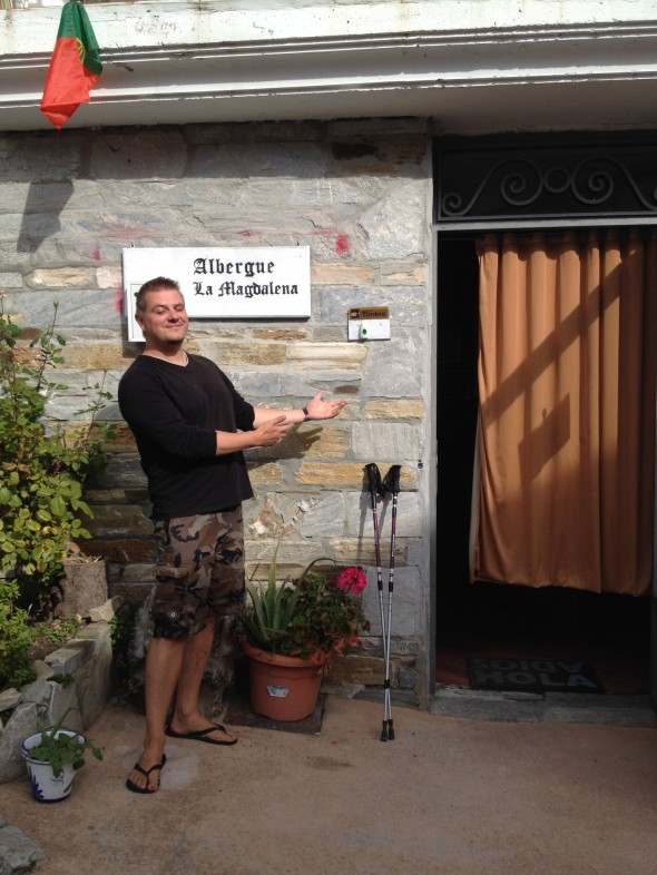 Matthew Sanchez, son of friend of my client Charlotte's,  at the entrance of his Albergue Magdalena in Vega de Valcarce.