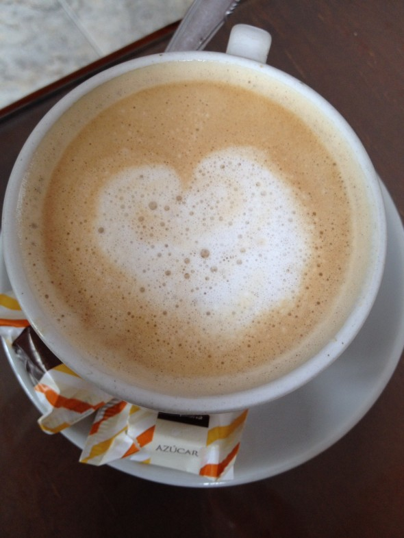 Cafe-con-leche at a tiny cafe we stopped in just before a downpour - lucky!!  ...I see a heart in this foam; do you?!