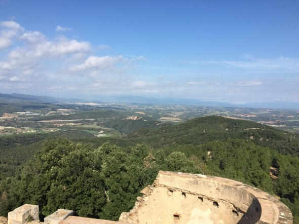 Atop a watchtower which was one of our points of interest along some trails outside the city, we can see part of Girona and the Pyrenees Mts.