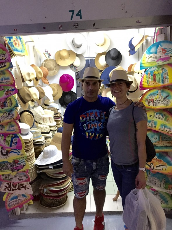 Orestes, hat designer and fitter in Booth #74 in the huge San Jose Market in Havana.