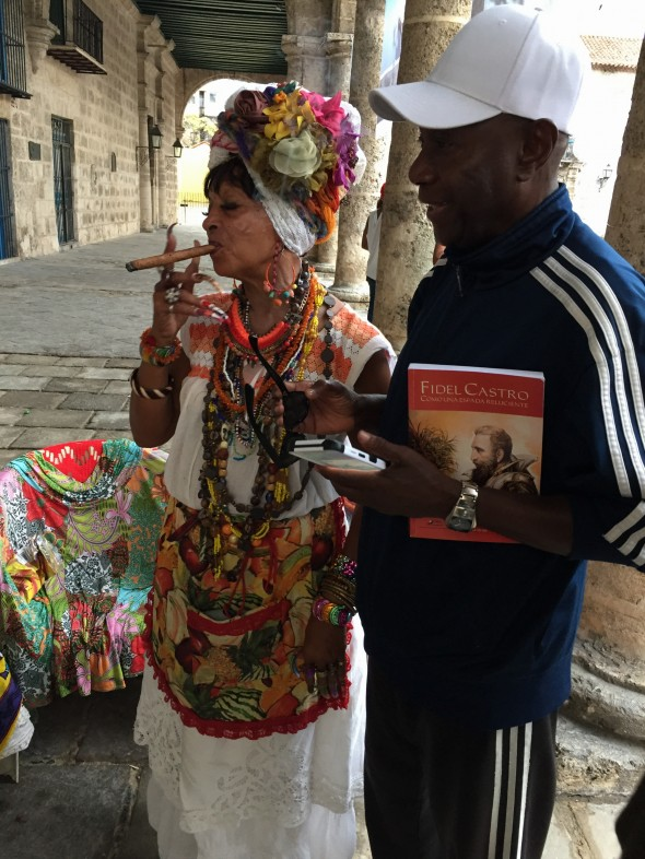 """Cleve and his Cuban friend and """"neighborhood mother"""", Adelaide.  Each group Cleve brings to Havana brings Adelaide some gifts to contribute to the annual party she throws for local children in January or February.  And yes her nails are a few inches long and she smokes a cigar."""