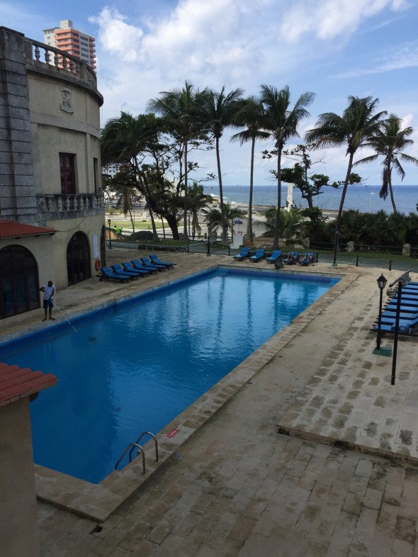 During Hurricane Irma in early September 2017 the Nacional Hotel fared pretty well, according to our tour guide.  The building was constructed with steel beams, and is super-sturdy to stand up to hurricane-level winds.  The hotel is right off the ocean, as you can see in the background of this swimming pool setting.  Many tourists utilized the Nacional Hotel for shelter during the hurricane.