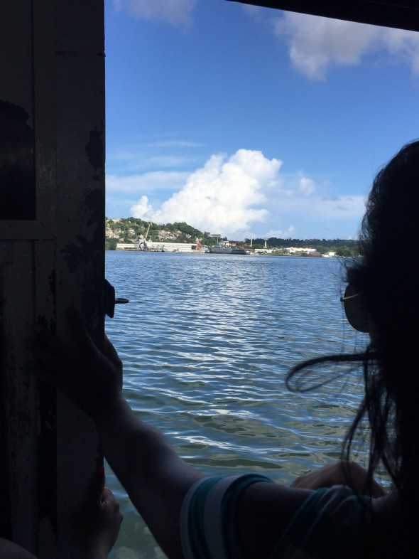 Looking back at the Havana harbor over someone's shoulder through the door-opening of the ferry on the way to the little town of Regla
