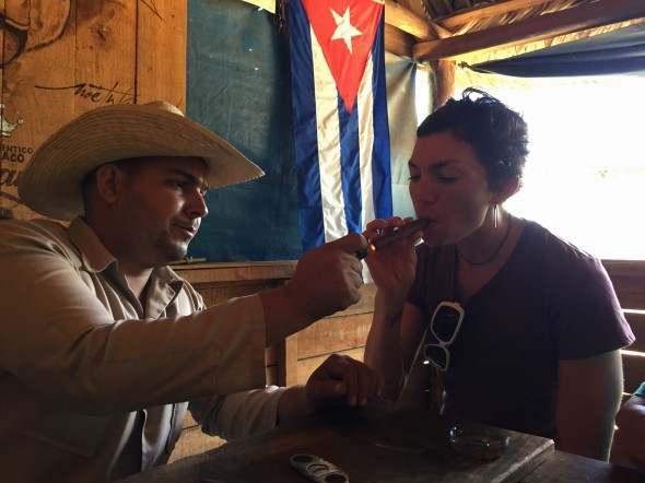 """""""When in Rome...""""  I just had to try one of these organic authentic Cuban cigars that was hand-rolled right in front of me!  You dip the end into honey then put that in your mouth before lighting it."""