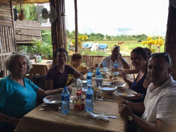 Our group lunching at a family-style Cuban BBQ place, with a beautiful peaceful backdrop of some of the Vinales Valley (too bad it's pretty washed out in this photo!)
